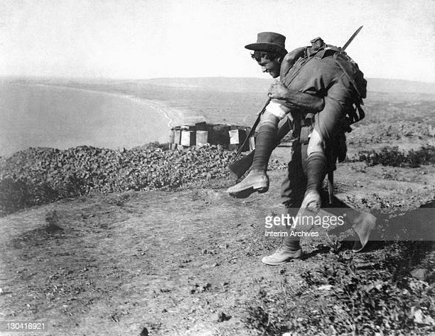 An Australian soldier carries a wounded comrade to a hospital during the Dardanelles Campaign 1915 US War Department photo