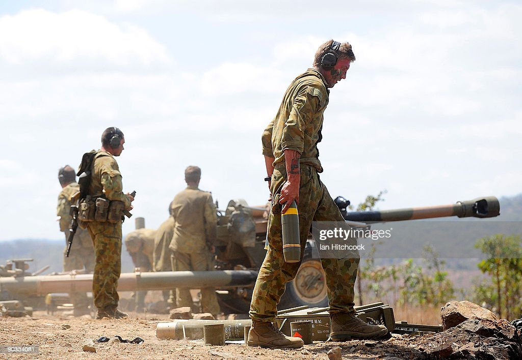 An Australian soldier from the 4th Field Artillery Regiment carries