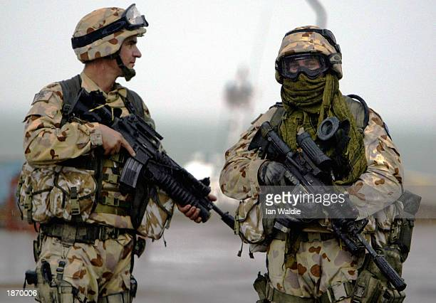 An Australian soldier from the Royal Australian Navy stands guard at the old port March 25, 2003 in Umm Qasr, Iraq. The port town, on the Kuwait-Iraq...