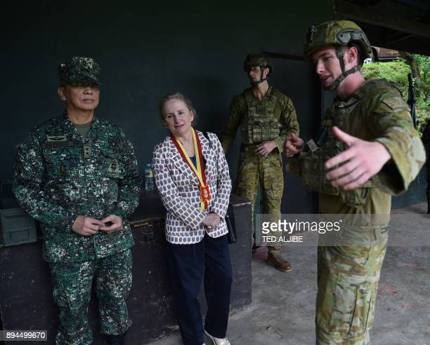 An Australian soldier gestures as he speaks to Australian ambassador to the Philippines Amanda Gorely and Philippine Marine commandant Major General...