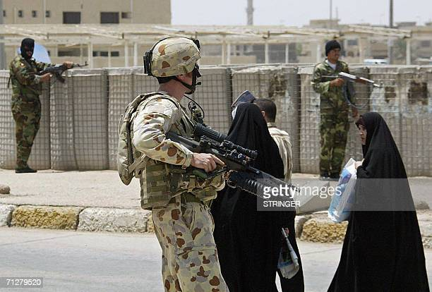 An Australian soldier guards the area during a joint street patrol with Iraqi security forces in the Iraqi southern city of Samawa 22 June 2006...