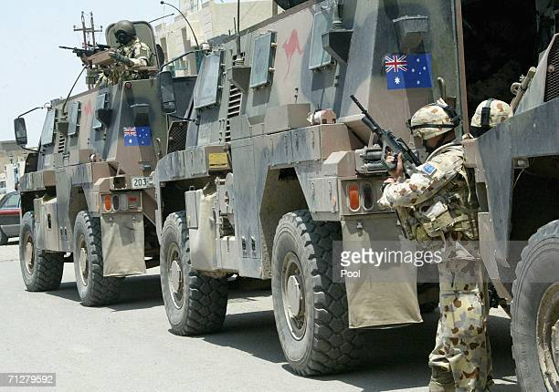 An Australian soldier guards the area during a joint street patrol with Iraqi security forces on June 22 2006 in Samawa south of Baghdad Iraq...