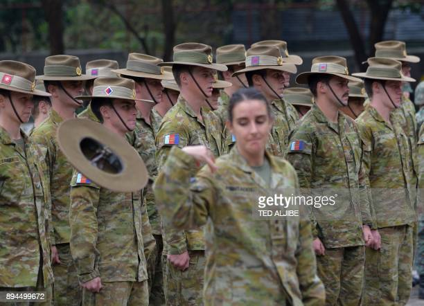 An Australian soldier loses her hat due to strong winds during the closing ceremony of the Military Operation Urbanized Terrain training exercises...