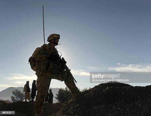 An Australian soldier of Omletc company keeps vigil outside the district administration office called the 'White Compound' in Mirwais in the southern...