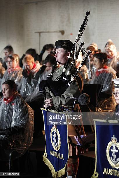 An Australian soldier plays the bagpipes during a dawn service at the Australian War Memorial on April 25 2015 in VillersBretonneux France The day...