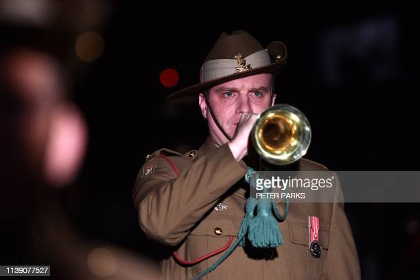 An Australian soldier plays The Last Post at the Cenotaph during the Anzac Day dawn service in Sydney on April 25 2019 Dawn services were held across...