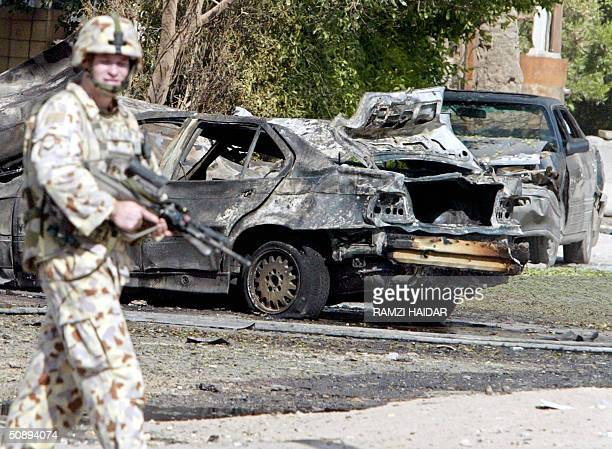 An Australian soldier secures the site where car bomb exploded outside a hotel close to Australia's diplomatic mission in Baghdad 25 May 2004 Police...
