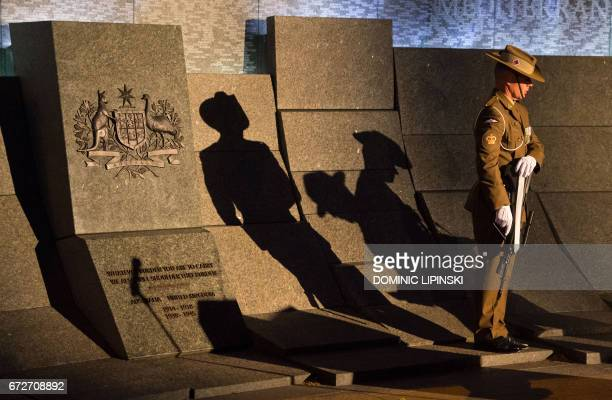 TOPSHOT An Australian soldier stands at the Australian War Memorial during an Anzac Day dawn service at Hyde Park Corner in London on April 25 2017...