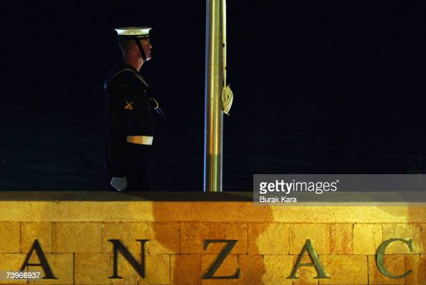 An Australian soldier stands guarded as thousands of Australians and New Zealanders attend a dawn ceremony at Anzac Cove where the first battle was...