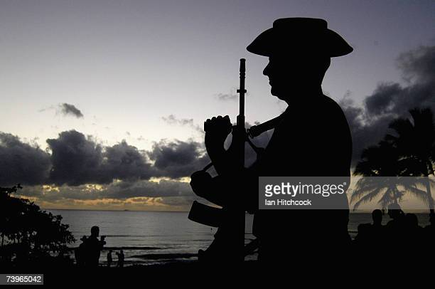An Australian soldier stands to arms during an ANZAC day commemorative service at Balgal Beach April 25, 2007. Australians and New Zealanders today...
