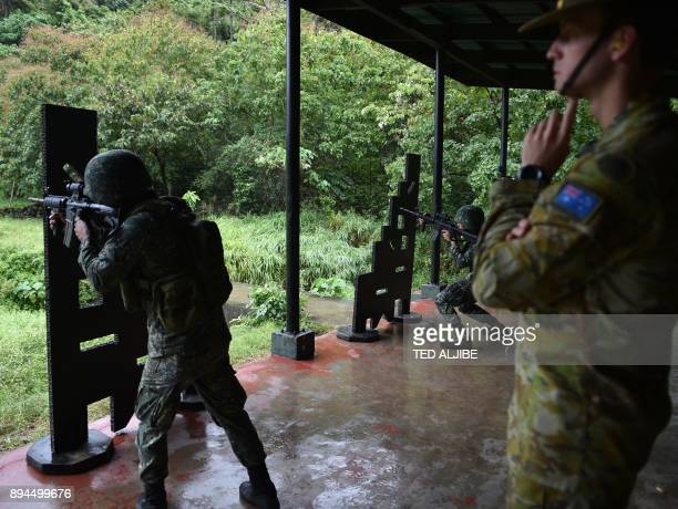 An Australian soldier supervises as a Philippine Marine aims at targets during the Military Operation Urbanized Terrain training exercises at the...
