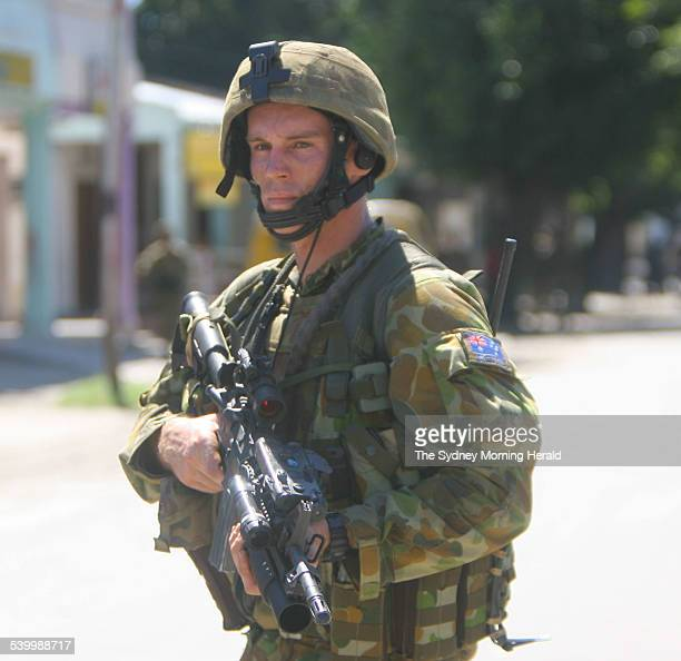 An Australian special forces soldier patrols a street in the East Timorese capital Dili after days of street fighting 26 May 2006 SMH Picture by...
