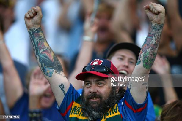 An Australian supporter celebrates after the final siren during game two of the International Rules Series between Australia and Ireland at Domain...