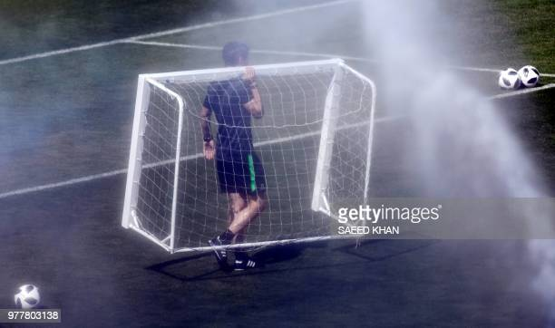 TOPSHOT An Australia's team official carries a goal post during a training session in Kazan on June 18 as part of the Russia World Cup 2018 football...