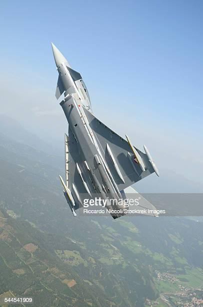An Austrian Air Force Eurofighter EF2000 Typhoon during a step climb over the Austrian Alps.
