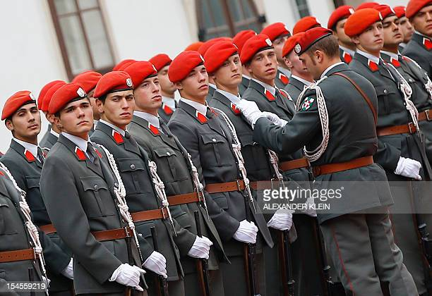 An Austrian army officer adjusts the uniforms of a soldier as they position for a guard of honor prior to the visit of Kazakhstan's President...