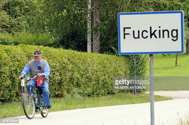 An Austrian man riding a bicycle leaves the village of Fucking some 35 km North of Salzburg on June 18 2008 The village name attracts many foreign...