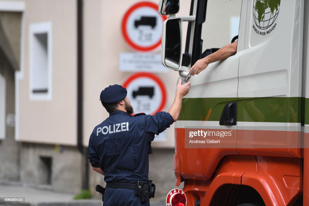 An Austrian police officer checks a truck at a checkpoint at the border between Austria and Italy prior to the European Union member states' interior and justice ministers conference on July 11, 2018 in Innsbruck, Austria. The meeting is taking place among mounting efforts by governments across Europe to restrict the entry of migrants and refugees.