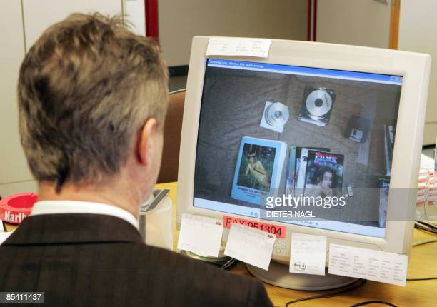 An Austrian Police Officer reviews data on a computer screen showing explicit photos concerning the legal act 'Sledgehammer' against worldwide child...