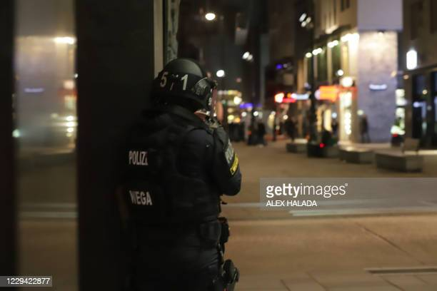 An Austrian policeman overlooks an area in Vienna on November 2 after a shooting in the city centre. - Multiple gunshots were fired in central Vienna...