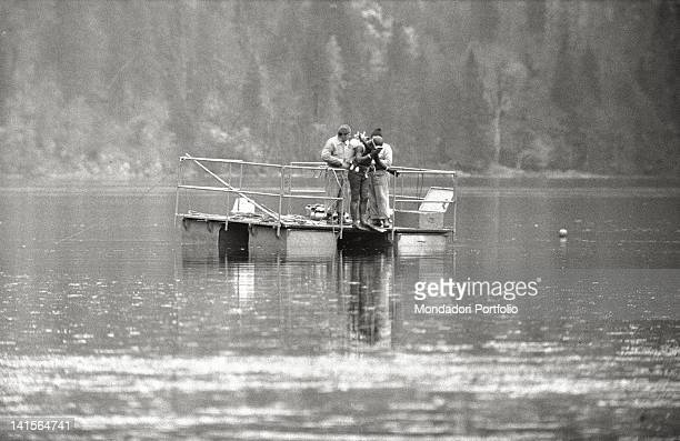 An Austrian scuba diver plunging into Lake Toplitz to sound its bottom in search of Hitler's treasure Austria 1960s