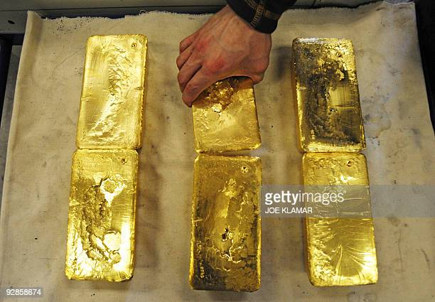 An Austrian worker handles tenkilogram gold bars at Austrian gold bullion factory Oegussa on October 8 2008 in Vienna Oegussa announced on October 6...