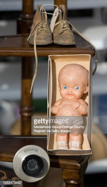 An authentic 1940s Kewpie doll beckons shoppers from Kate Paragone's booth Chadod during the Trading Post 1908 antique show in Anaheim INFO Photo by...