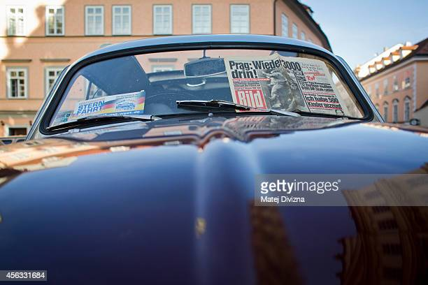 An authentic issue of German Bild newspaper from 1989 is placed on the Trabantbrand car at a commemoration event to the 25th anniversary of refugee...