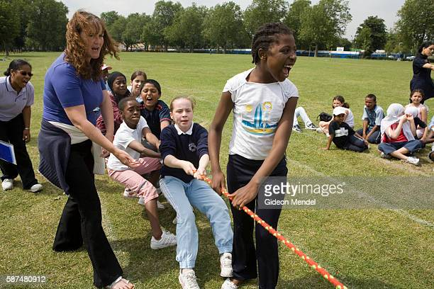 An autistic child at Millfields Community School participates in a tug-of-war contest along with the other children during their sports day held in a...