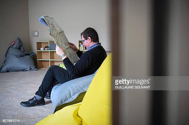 An autistic young adult looks at a map at the association 'Vivre et Travailler autrement' on November 24 2016 in AuneauBleurySaintSymphorien Seven...