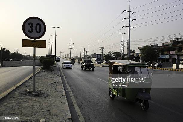 An auto rickshaw and other vehicles travel past a speed limit sign along a road in Rawalpindi, Punjab, Pakistan, on Tuesday, Oct. 4, 2016. Pakistan...
