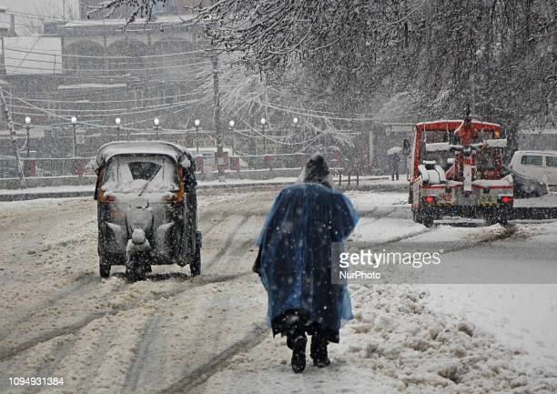 An auto rickshaw moves as it snows heavily in SrinagarKashmir on February 07 2019 Heavy snowfall in the Kashmir valley has adversely affected life...