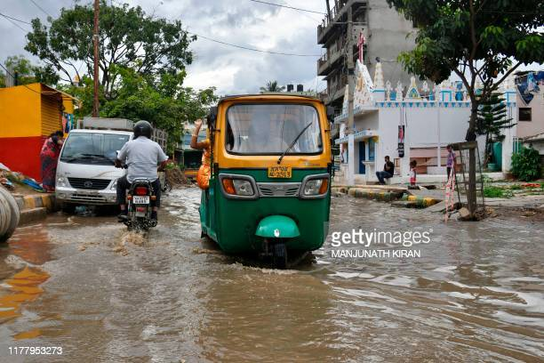 An auto rickshaw wades through a flooded street in Bangalore after rain showers on October 24 2019