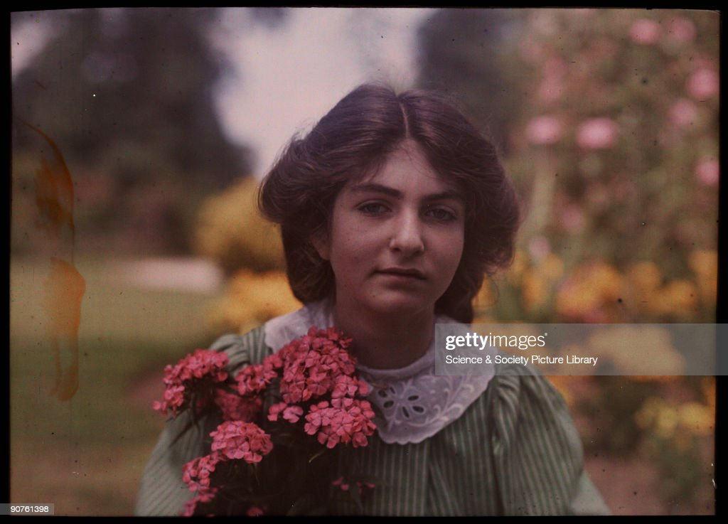 Girl with a bunch of flowers, 1908. : News Photo