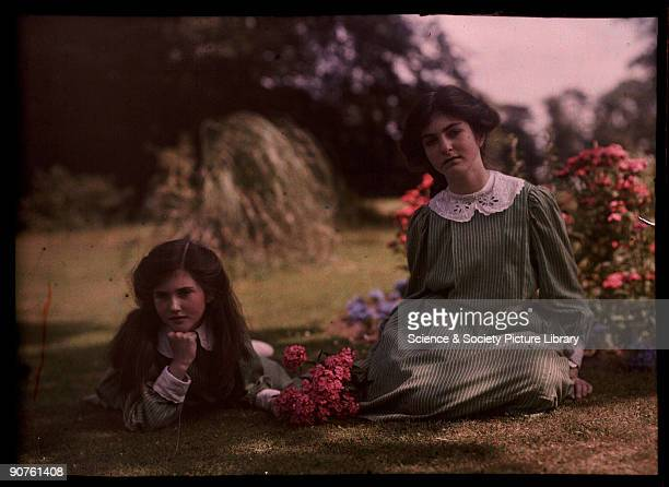 An autochrome of her daughters by Etheldreda Janet Laing The two sisters dressed in matching greenstriped dresses relax on the grass in this sunny...