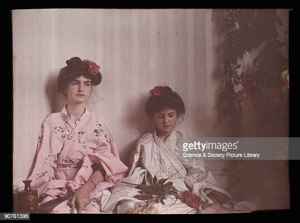 An autochrome of her daughters dressed in Japanesestyle outfits taken by Etheldreda Janet Laing in 1908 They both have flowers in their hair which is...
