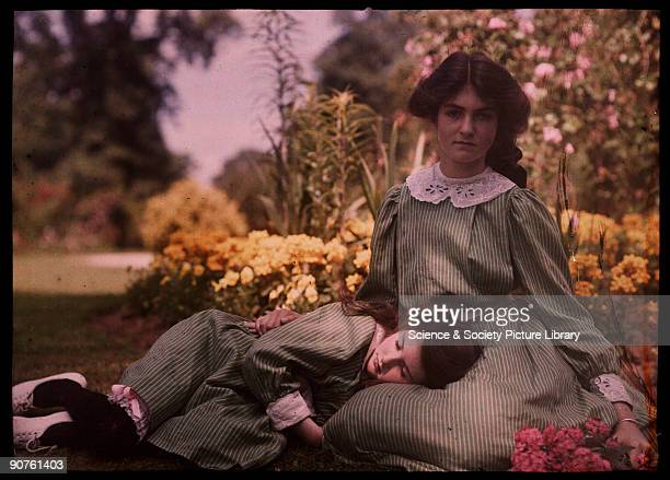 An autochrome of two sisters daughters of the photographer together in a garden on a hot summer�s day taken by Etheldreda Janet Laing The younger...