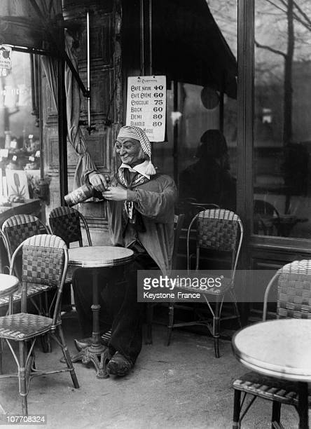 An Automated Advertising Wearing The Traditional Costume Norman Who Settled In The Terrace Of A Parisian Cafe