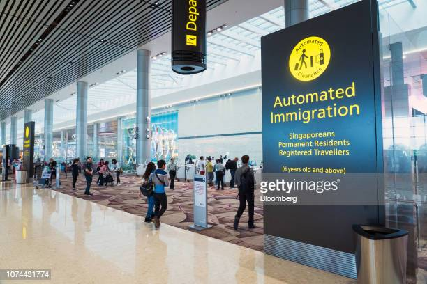 An 'Automated Clearance' sign is displayed at automated boarding gates at Terminal 4 of Changi Airport in Singapore on Thursday Dec 13 2018...