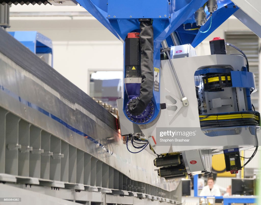 An automated fiber placement machine builds part of a wing