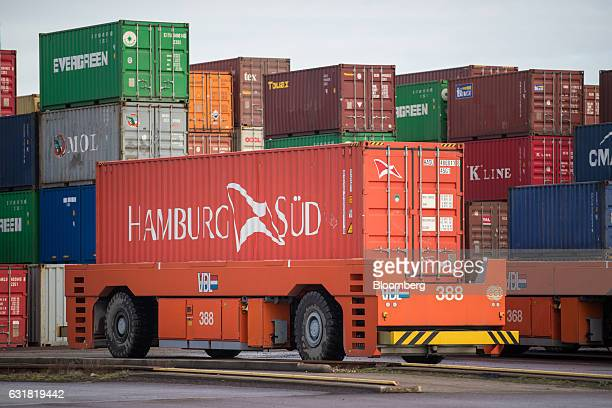 An automated guided vehicle transports a Hamburg Sued shipping container on the dockside at the Delta Terminal operated by Europe Container Terminals...