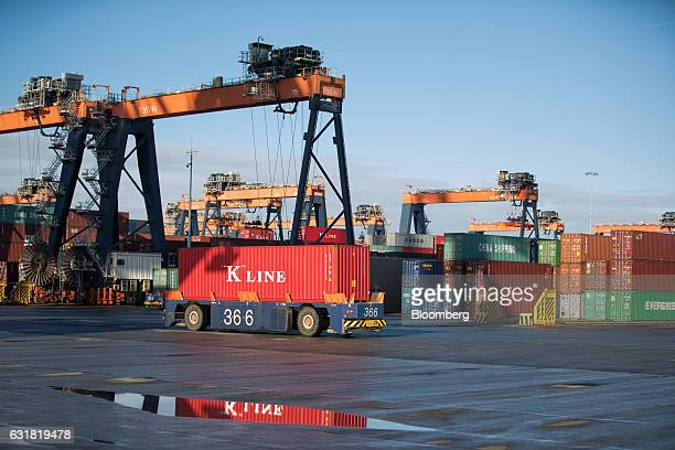 An automated guided vehicle transports a K Line shipping container on the dockside at the Euromax terminal operated by Europe Container Terminals BV...