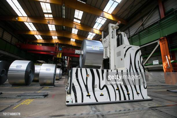 An automated guided vehicle transports a steel coil at the Thyssenkrupp Rasselstein GmbH steel packaging factory in Andernach Germany on Thursday Aug...