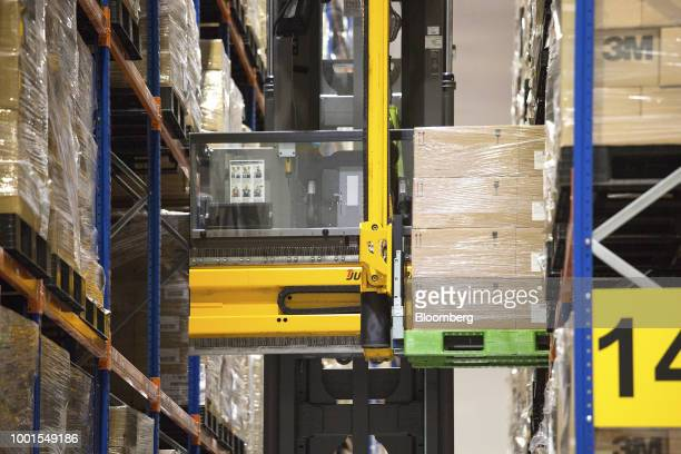 An automated guided vehicle transports boxes inside the Toll City warehousing facility operated by Toll Holdings Ltd a unit of Japan Post Holdings Co...