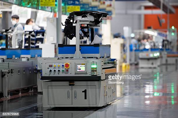 An automated guided vehicle transports part of a module on a production line at the Hyundai Mobis Co factory in Asan South Chungcheong South Korea on...
