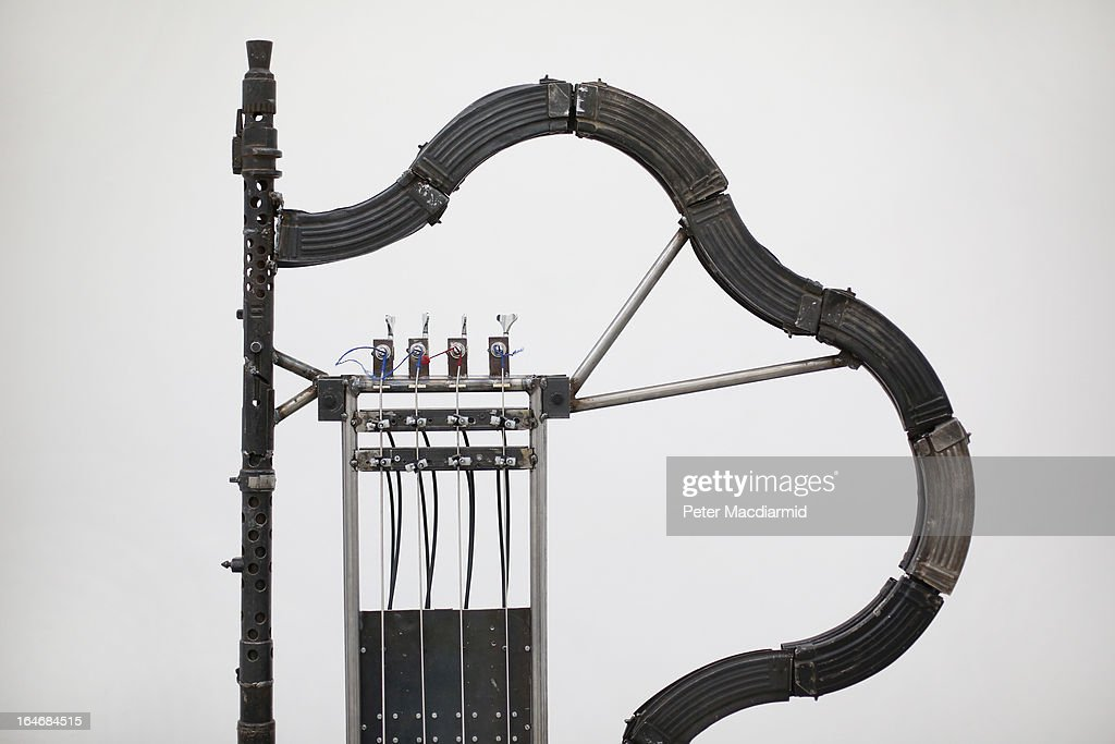 An automated musical instrument made from recycled gun parts is shown at Pedro Reyes' exhibition at the Lisson Gallery on March 26, 2013 in London, England. Mexican artist Pedro Reyes received 6,700 destroyed weapons from the Mexican government from which he sculpted two groups of instruments. The first, a series titled Imagine, is an orchestra of fifty instruments, from flutes to string and percussion instruments, designed to be played live. The second, Disarm, is an installation of mechanical musical instruments, which can either be automated or played live by an individual operator using a laptop computer or midi keyboard.