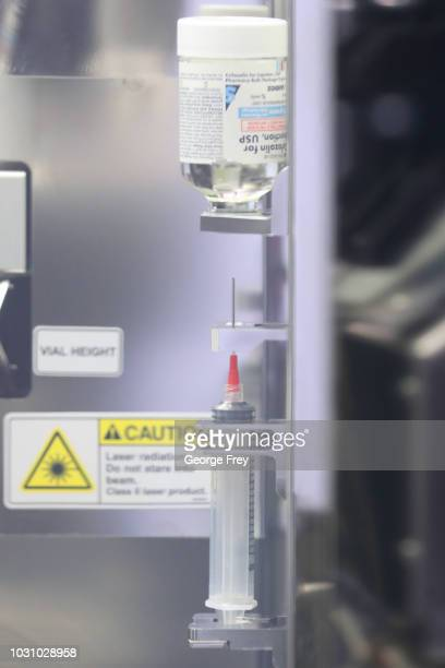 An automated robot prepares IV solutions at the central pharmacy of Intermountain Heathcare on September 10 2018 in Midvale Utah IHC along with other...