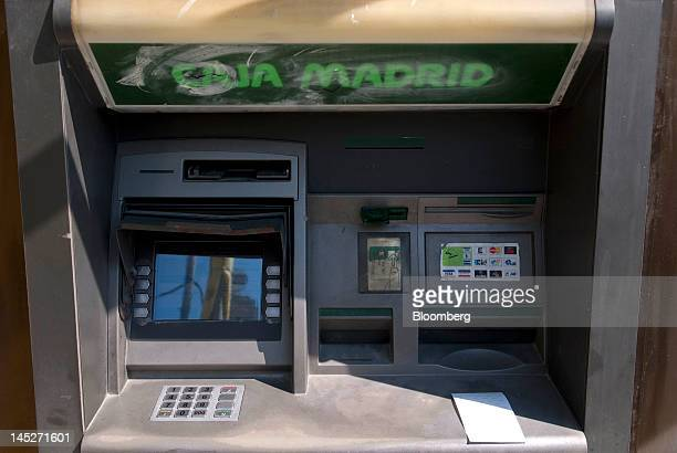 An automated teller machine is seen outside a Caja Madrid bank branch part of the Bankia group in Barcelona Spain on Friday May 25 2012 The Bankia...
