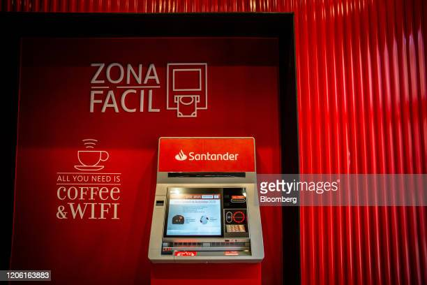 An automated teller machine sits inside the Banco Santander SA Work Cafe coworking space in Barcelona Spain on Friday March 6 2020 Spanish bank...
