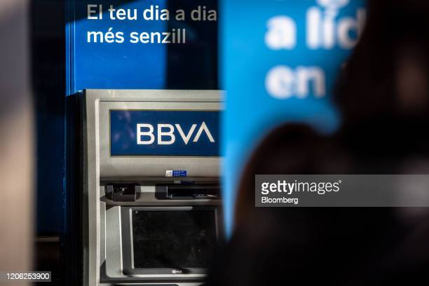 An automated teller machine sits outside a Banco Bilbao Vizcaya Argentaria SA bank branch in Barcelona Spain on Saturday March 7 2020 Spanish bank...